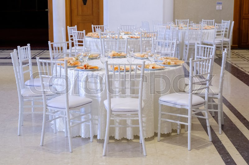 Gorgeous wedding chair and table setting for fine dining, stock photo