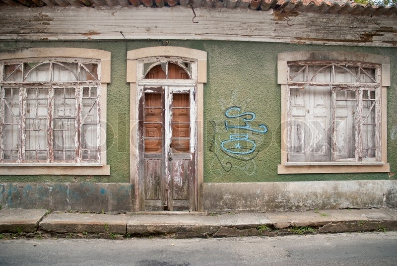 Old House Facade With Broken Door And Windows, Stock Photo