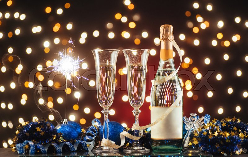 christmas and new year celebration with champagne new year holiday decorated table two champagne glasses against a dark background with gold shimmering