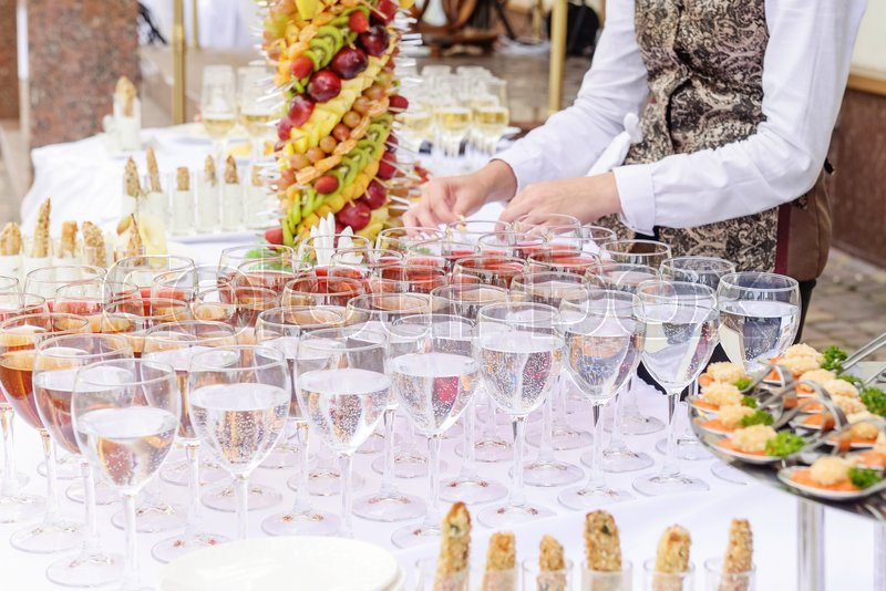Outdoor Beautifully decorated catering banquet table with different food snacks and appetizers on corporate party event or wedding celebration. Service concept. Selective focus. Close up, stock photo