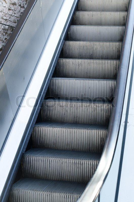 Electric escalators moving up, stock photo