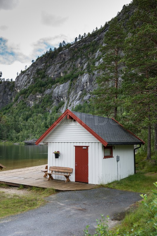 White typical wooden house in norway at the highlands near valle, stock photo