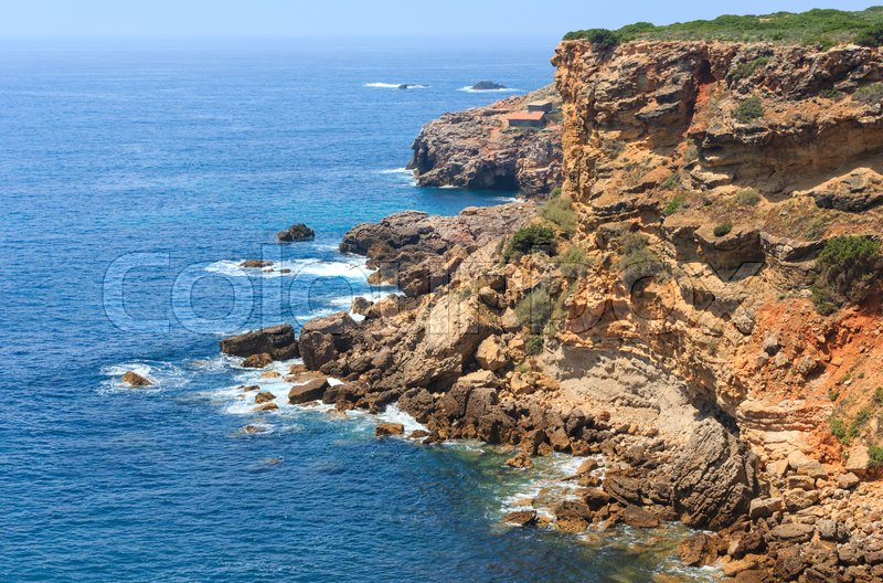 Summer Atlantic rocky coast view, Aljezur, Algarve west, Costa Vicentina, Portugal, stock photo
