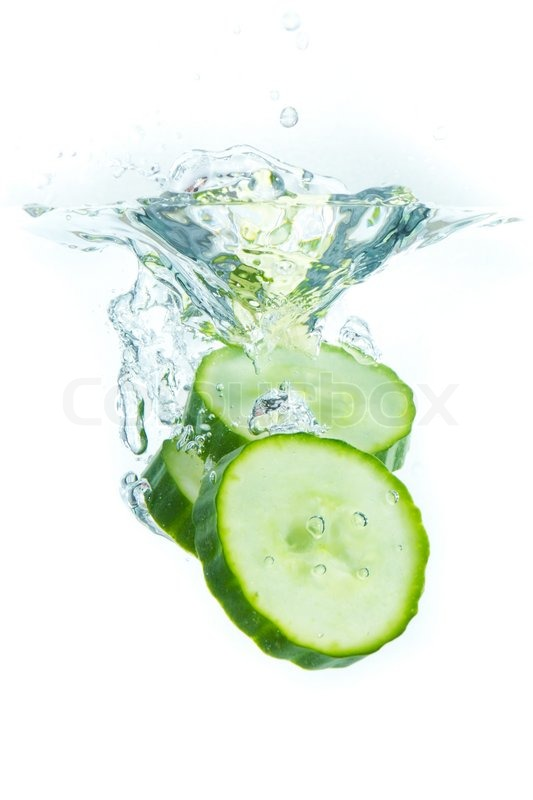 Sliced Cucumber Splashing Water Isolated On White