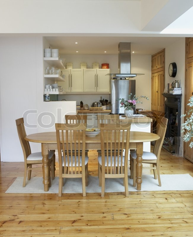 Stock image of 'Empty kitchen and dining room with open floor plan'