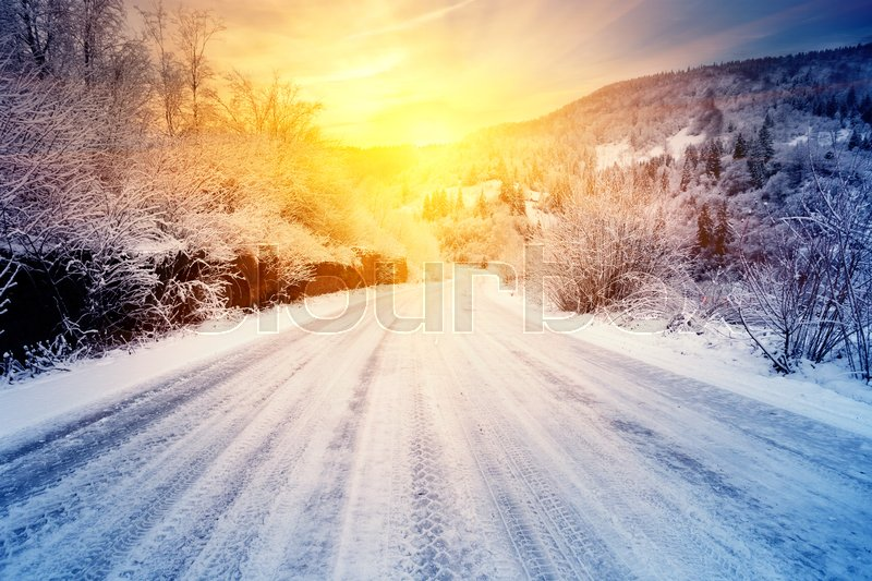 Road to the sunset in the winter mountains. Winter landscape. The concept of aspiration and movement. Toning, stock photo