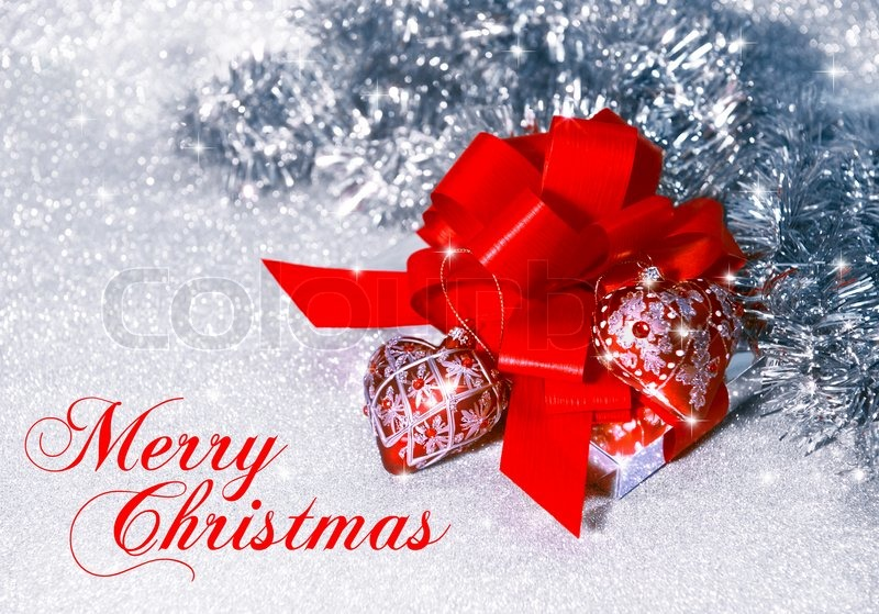 christmas gift with red ribbon on silver shiny background