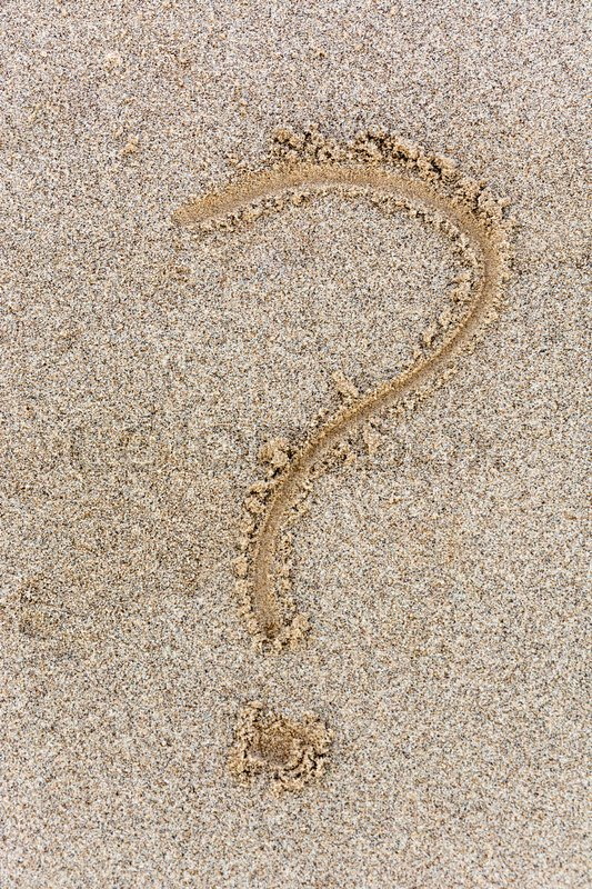 Stock Bild von 'A question mark drawn in the sand from above'