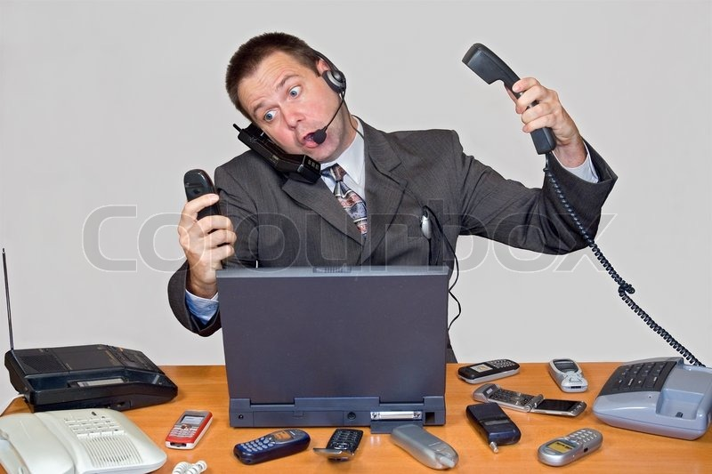 Stock image of 'Businessman in office'