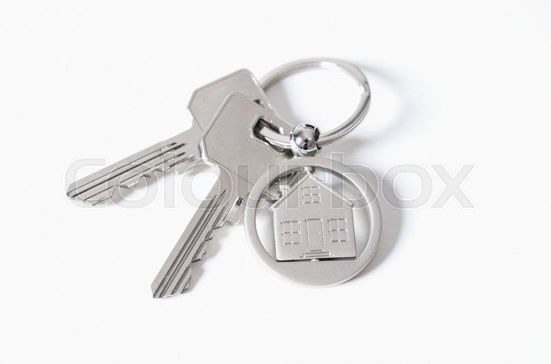 House key on a house shaped pendant real estate agent business card house key on a house shaped pendant real estate agent business card template stock photo colourmoves