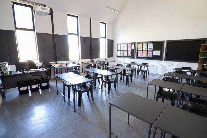 Modern Elementary School Classroom ~ Sunlit modern elementary school classroom stock photo