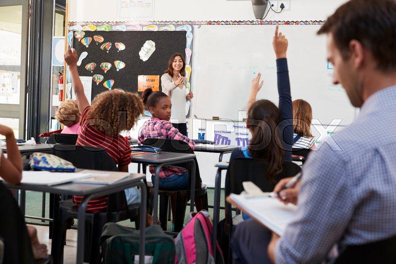 Trainee teacher learning how teach elementary students, stock photo