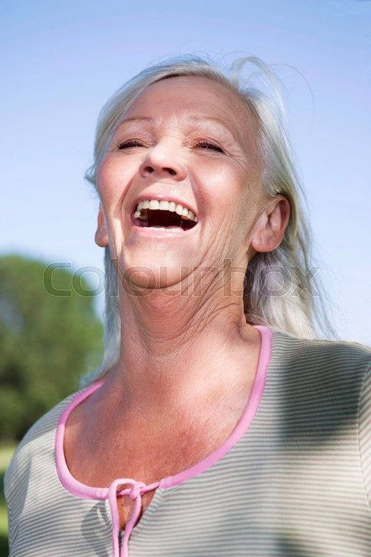 Mature woman portrait laughing, stock photo