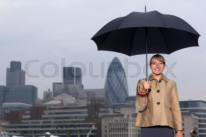 Woman with umbrella city scape, stock photo