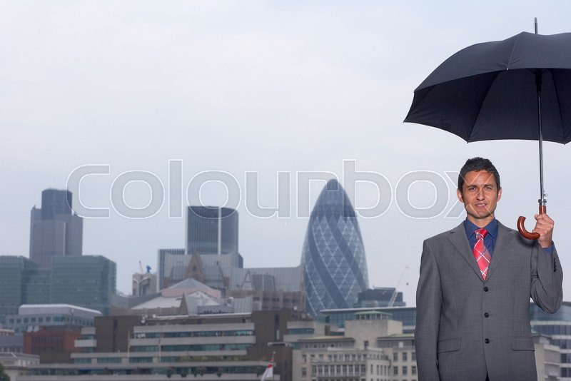 Mann with umbrella city scape, stock photo