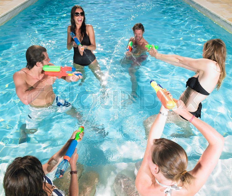 Water fight between young people, stock photo