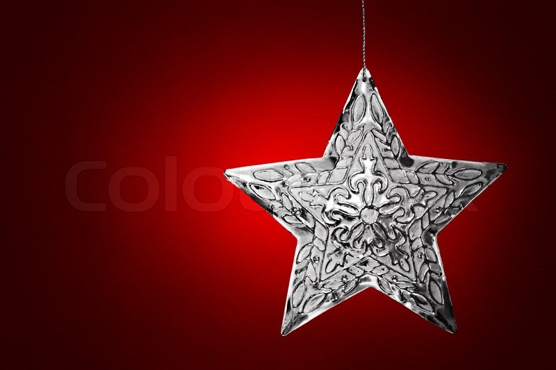 Silver Star Christmas Ornament Over Red Leather Background | Stock ...