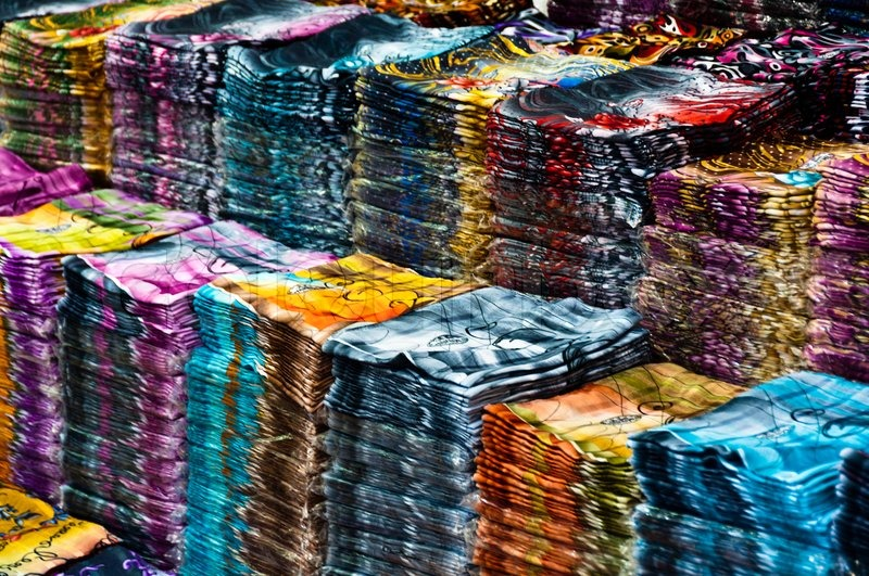 Large amount of cloths on stacks at wholesale store in Istanbul ...