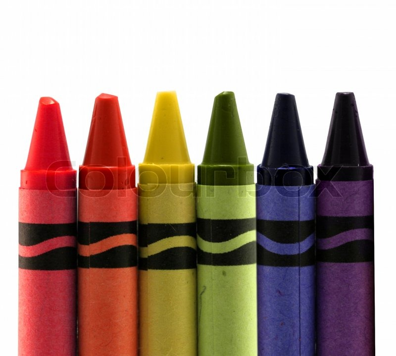 six used colored vax crayons form rainbow stock photo