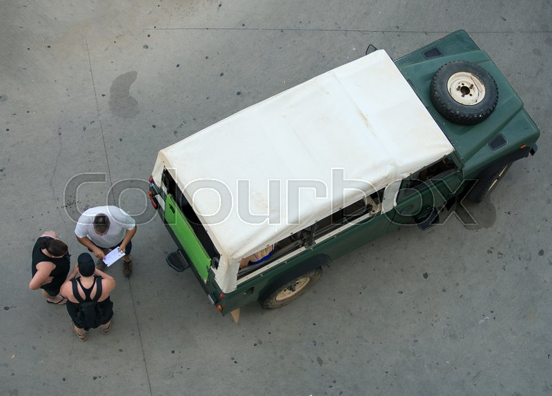 People are going on excursion on safari car, stock photo