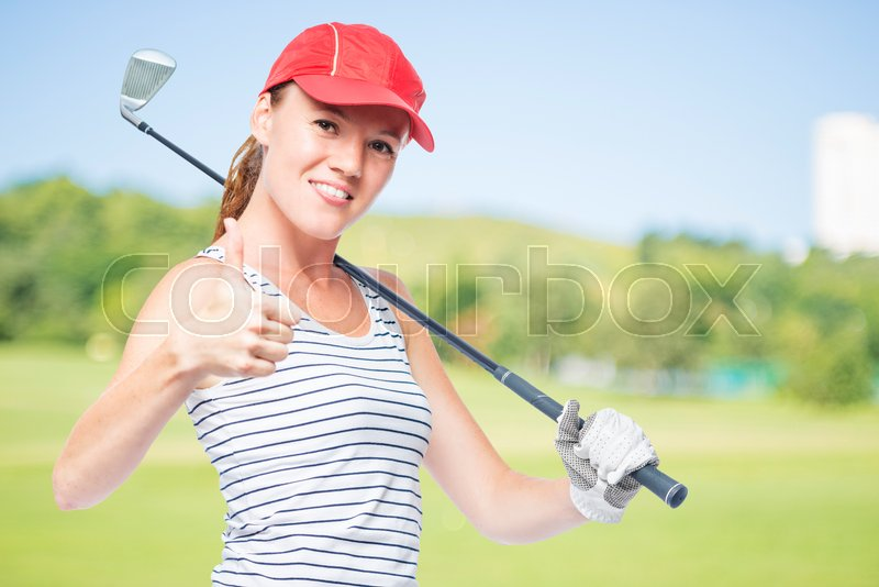 Golfer young and successful with golf club on a background of golf courses, right space, stock photo