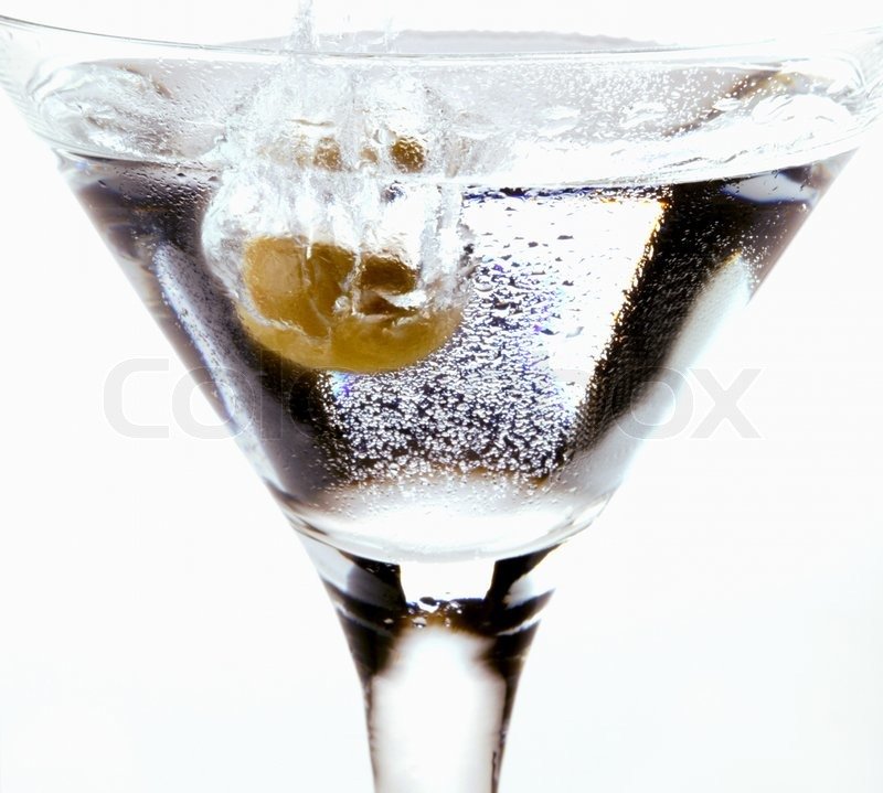 Olive Splashing In A Martini Glass Stock Photo Colourbox