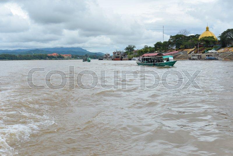Water transportation Mekong River, Thai - Myanmar boarder, stock photo