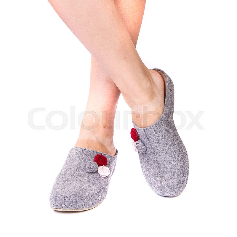 7c493ec053 Stock image of 'legs of a girl in summer orthopedic shoes on white isolated  background