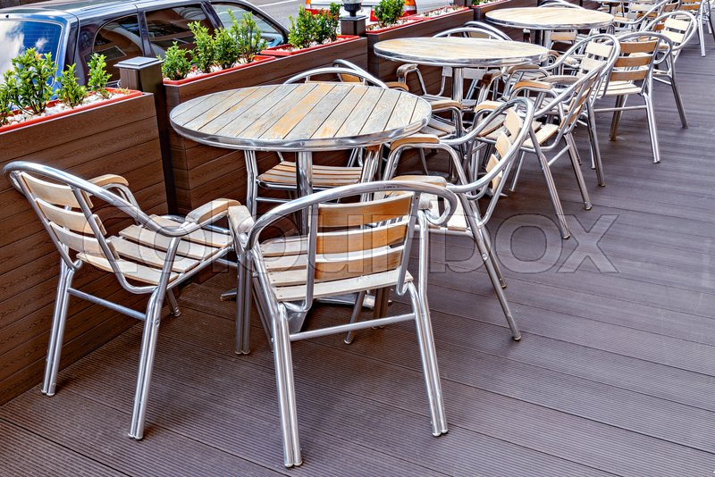Chairs and tables on the territory of the street restaurant, stock photo