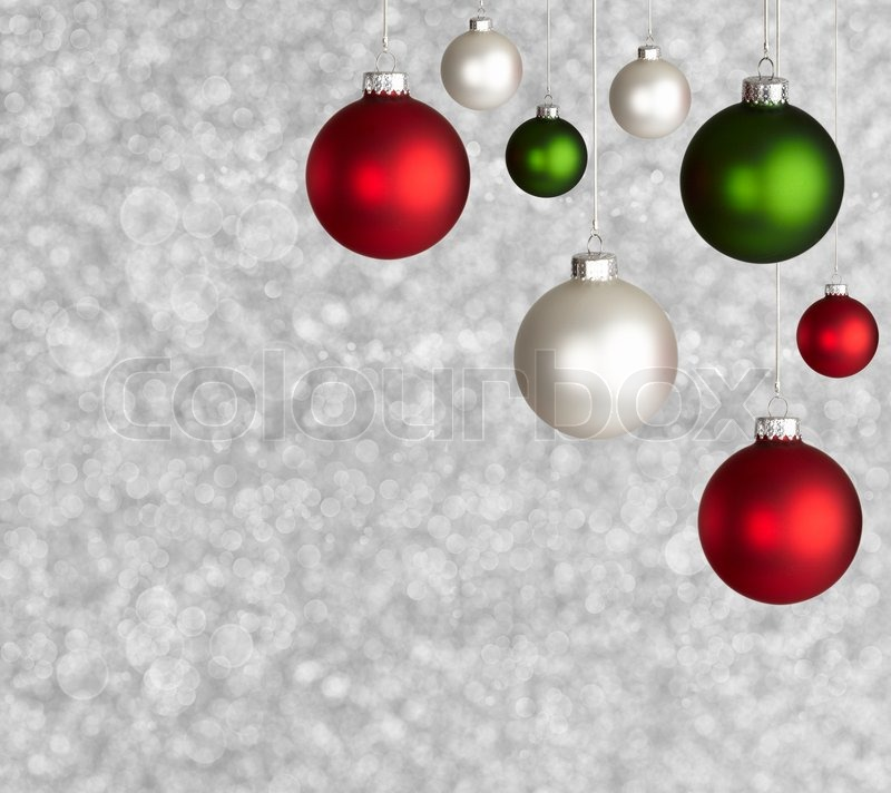 white red and green christmas ornaments on silver bokeh background stock photo colourbox