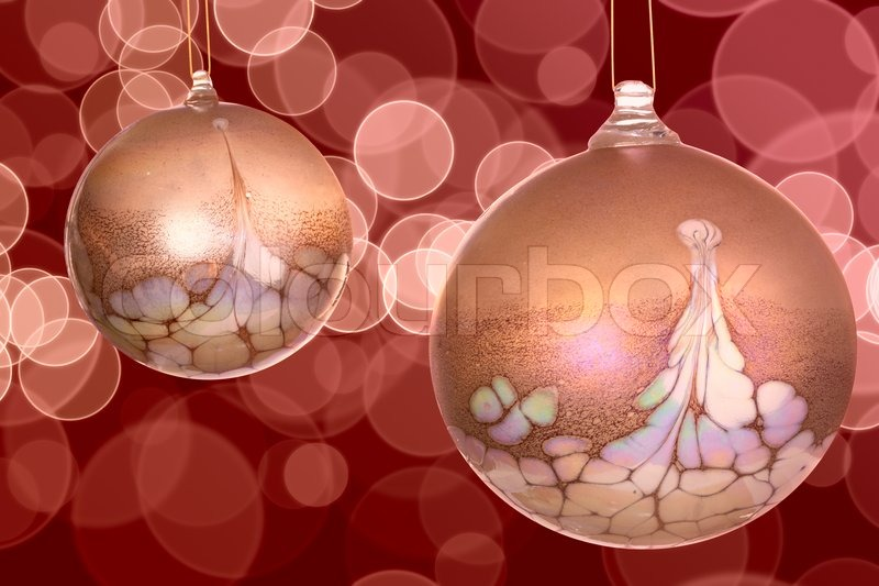 Golden White And Pink Christmas Ornaments On Colorful Red Bokeh Light Background