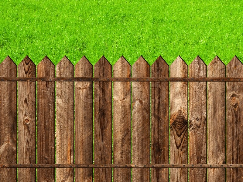 Wooden Fence Against The Green Grass Stock Photo Colourbox