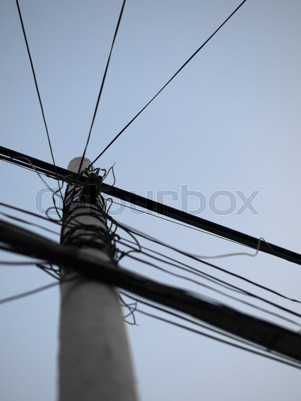 color photo of messy cable electricity post stock photo colourbox
