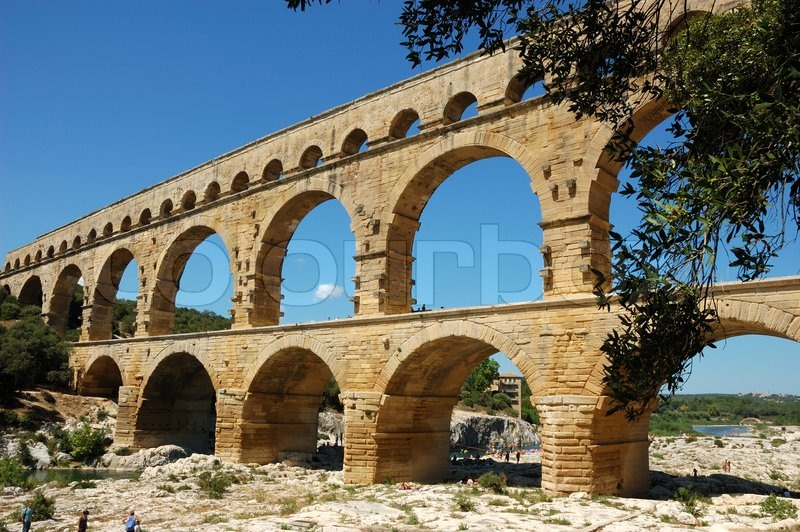 Ancient roman aqueduct pont du gard france stock photo for Pont du gard architecte
