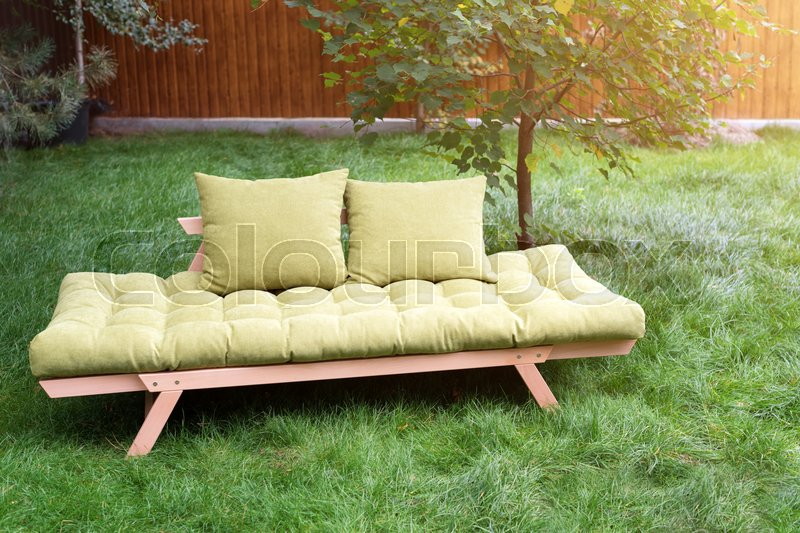 Green Sofa In The Yard Outdoors. Outdoor Furniture In Green Garden Patio. |  Stock Photo | Colourbox