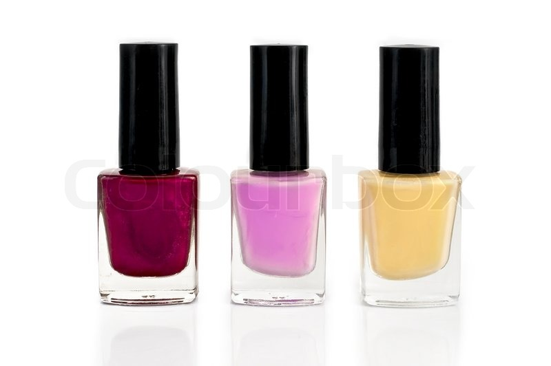 Three bottles with yellow, purple and pink nail polish ...