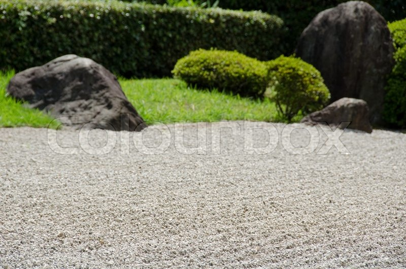 Stone Garden Of Zen Buddhism In Japan With Gravel Big Stones And Grass    Stock Photo   Colourbox