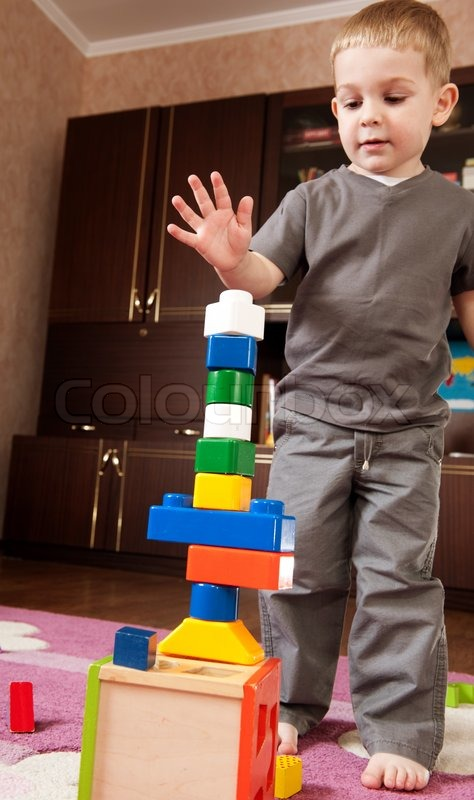 Building Toys For Little Boys : Little boy aged three is building a tower with toy blocks