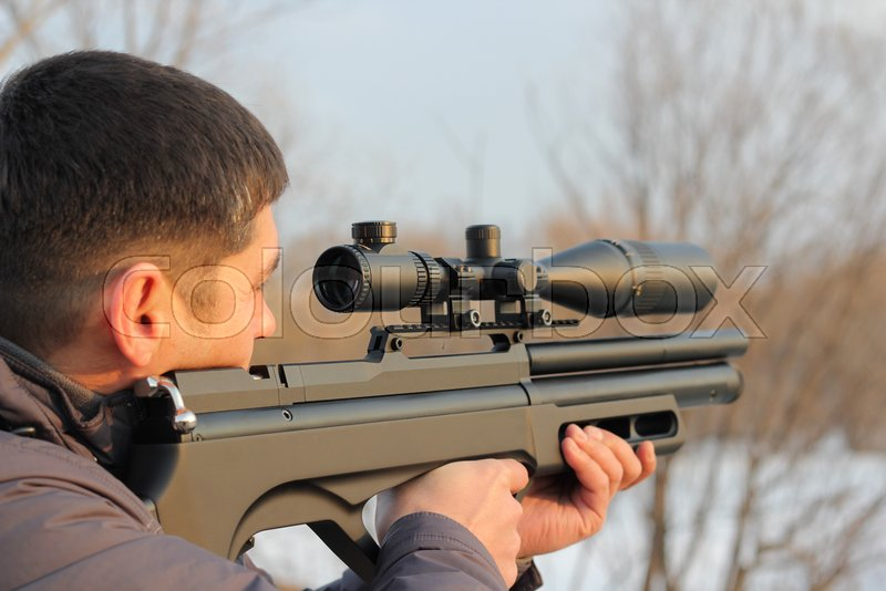 Hunter with rifle ready for shoot the target, stock photo