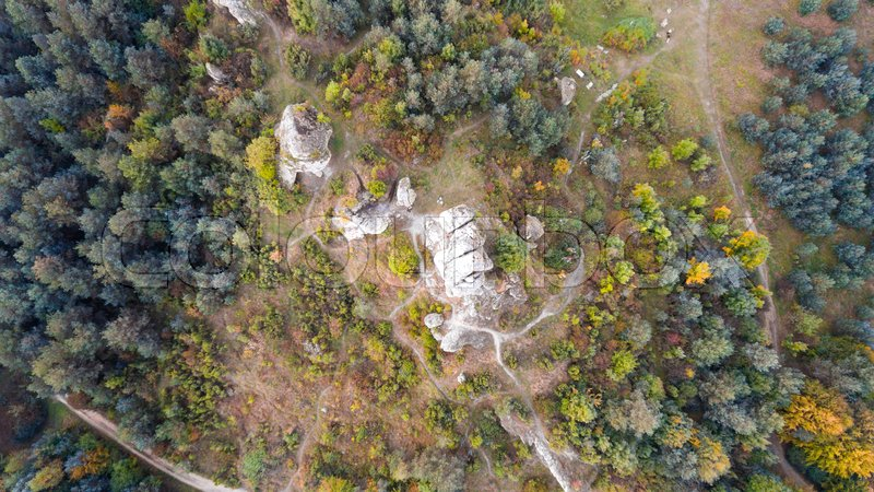 Forest and rocks in autumn aerial drone view, stock photo