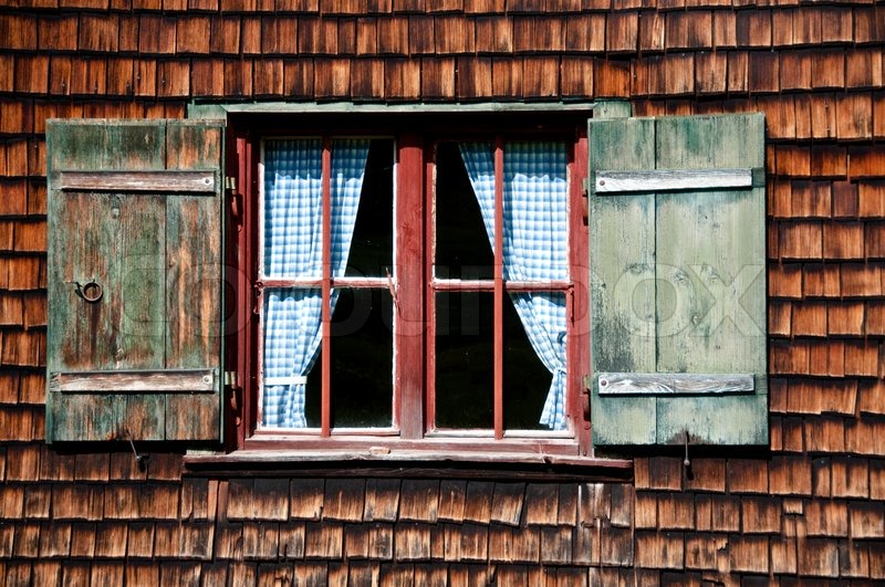 Beautiful ancient window on log house with wooden wall and for Einfache fenster