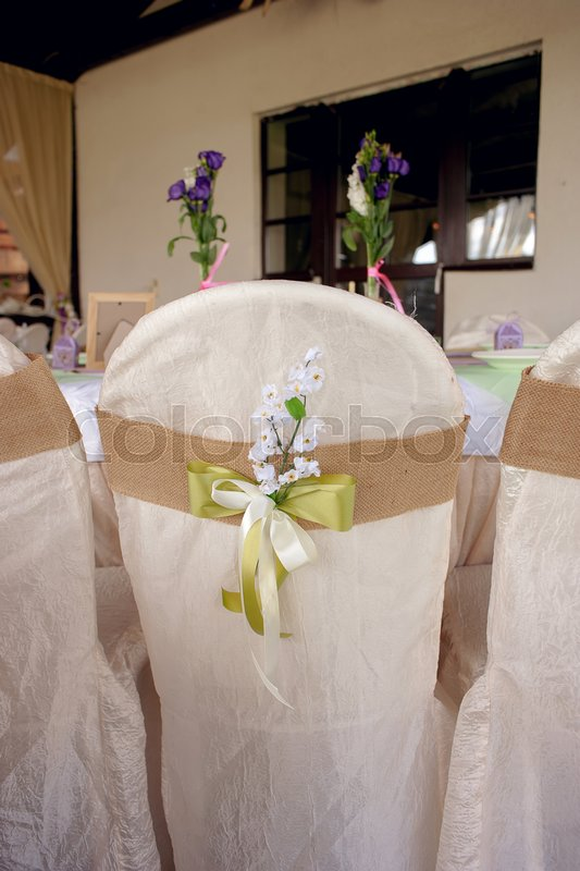 Beautifully decorated table for the wedding ceremony. Served banquet table decorated with fresh flowers in the open air, stock photo