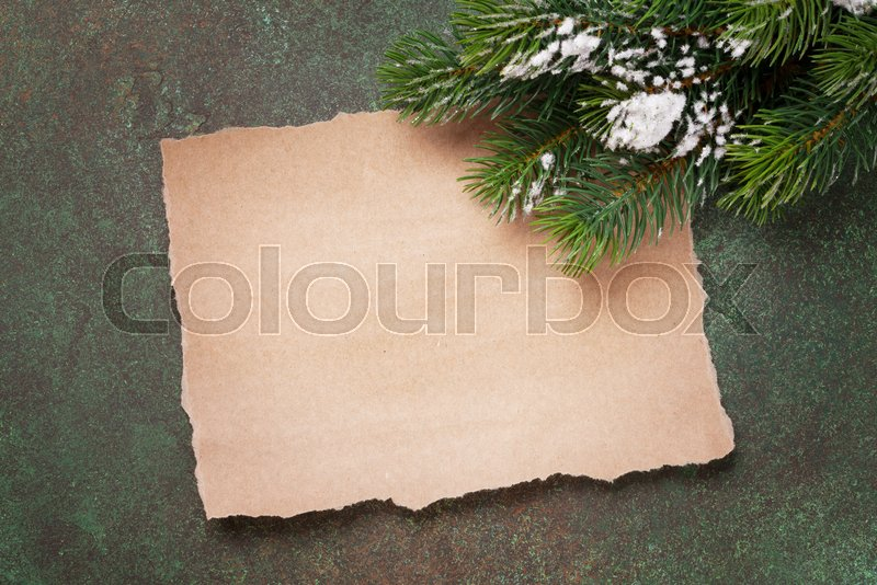Piece of paper for christmas wishes and snow xmas tree. Top view with space for your text, stock photo