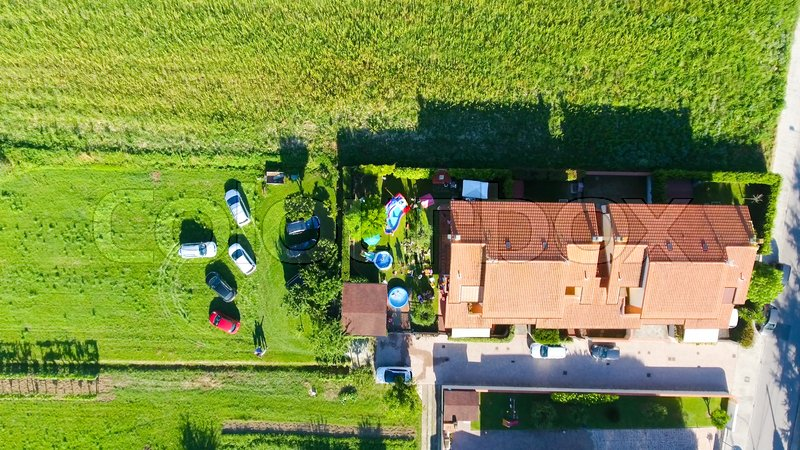 Children playing outdoor in a house garden, overhead view, stock photo