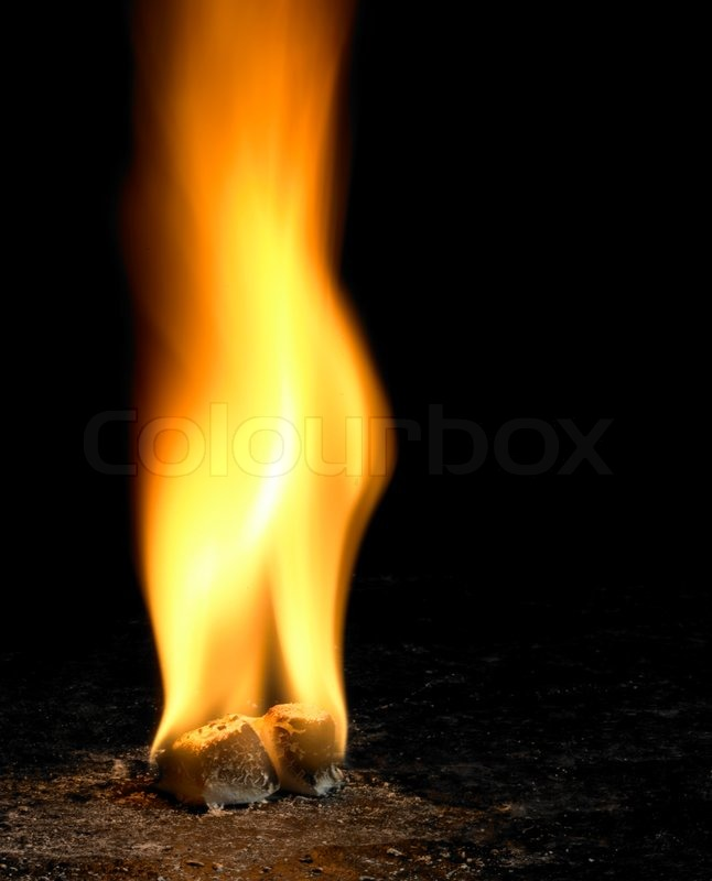 Big Flame On Small Burning Cubes In Dark Back Stock