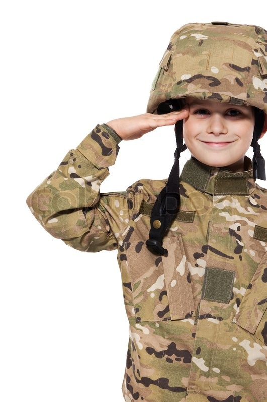 Stock image of 'Saluting soldier Young boy dressed like a soldier