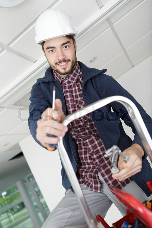 Electrician manual worker construction worker, stock photo