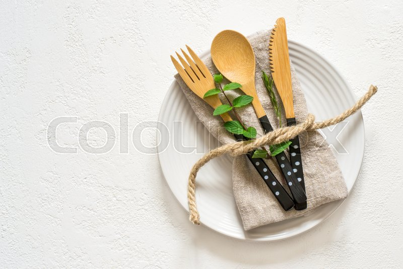Natural table setting with bamboo knife fork and spoon, Top view with copy space, stock photo