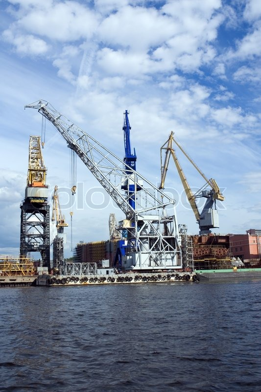 Large Construction Cranes : Large construction cranes in shipyard stock photo
