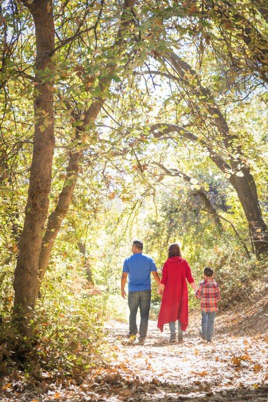 Mixed Race Caucasian and Hispanic Family Taking a Walk At The Park, stock photo